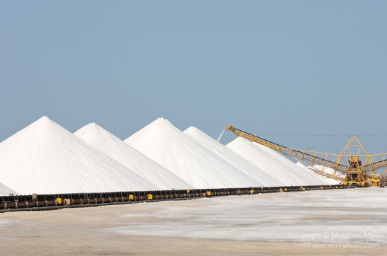 Bonaire, Netherlands Antilles; large, white piles of sea salt at the Cargill Salt Bonaire production facility on the southern part of the island